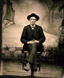 man sitting tintype