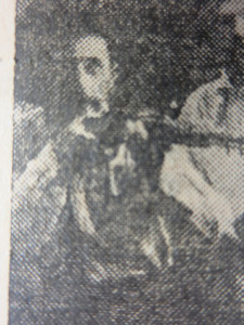 John Bracken holding a rifle. Detail from undated photograph. Galveston Daily News, 1921.